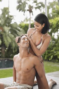 a woman touching her boyfriends hair
