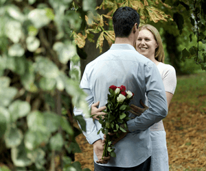 a man giving flowers to his lover