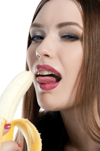 a woman practicing oral sex on a banana