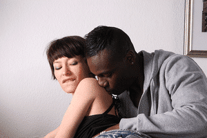 a man kissing a woman's shoulder