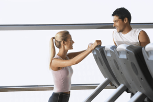 a man and woman flirting at the gym