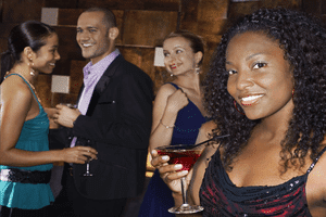 a woman wearing an attractive black dress at a party