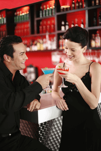 an attractive woman drinking wiht a man at a bar