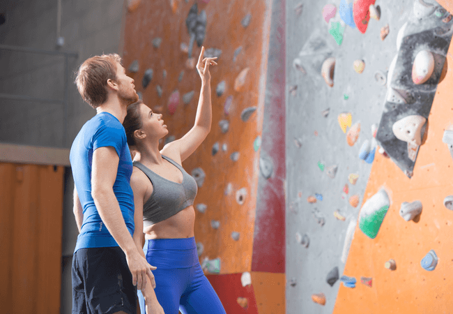 a couple rock climbing together