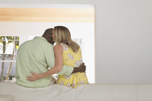 a woman talking dirty to her boyfriend on a bed