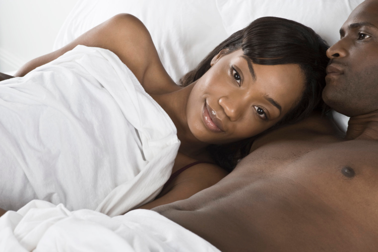 a man and woman in bed